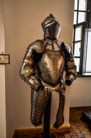 a suit of armor close-up, metal with a helmet