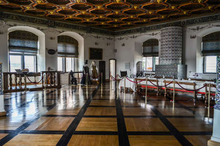 dining room in the castle with table chairs and kitchen appliances Redakční