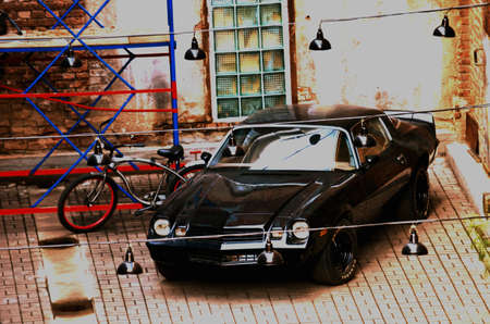 retro car near brick wall, Bicycle, scaffolding Redakční