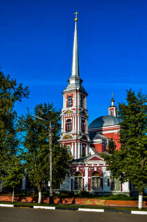 A small Church with a high spire and a cross on it Reklamní fotografie