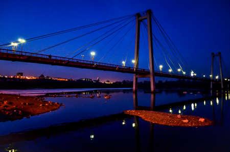 Pedestrian bridge over the Yenisei river in the late evening Reklamní fotografie