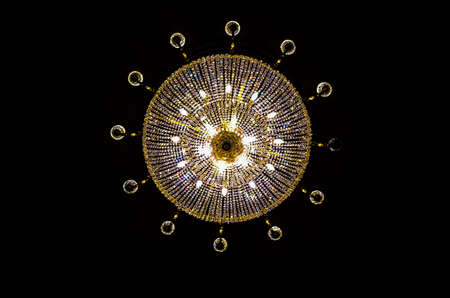 Chandelier view from below on black background, strong contrast