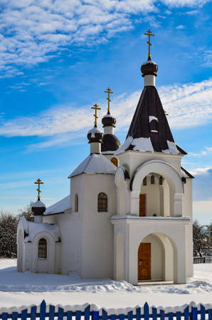 Church in winter, in clear weather and blue sky Reklamní fotografie