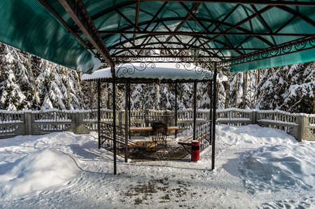 Barbecue in the gazebo under the canopy in winter