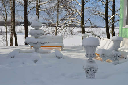 Small fountain in the snow in the Park in clear weather