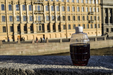 Bottle of wine against the city and river in the afternoon Reklamní fotografie