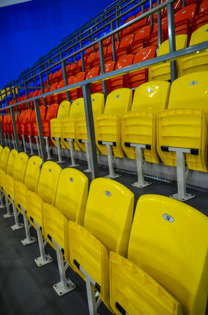 Chairs at the stadium of different colors are very bright