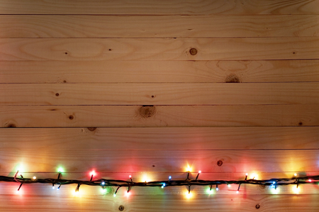 boarder: Christmas light boarder on wooden background. Stock Photo