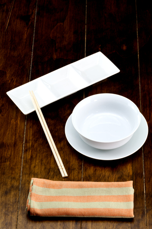empty bowl: Empty bowl on dish with chopstick , napery.