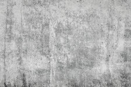 Gray concrete surface with cracks. An image of a cemented surface with a grunge, dirty stain, as an idea for making a background. Imagens
