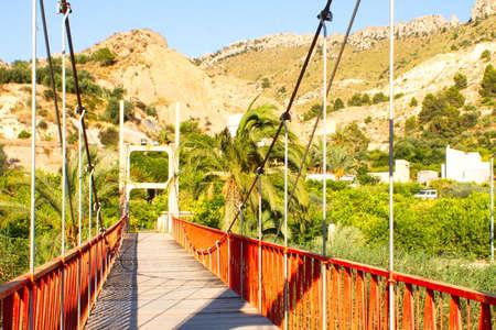 Suspension bridge across a river Imagens
