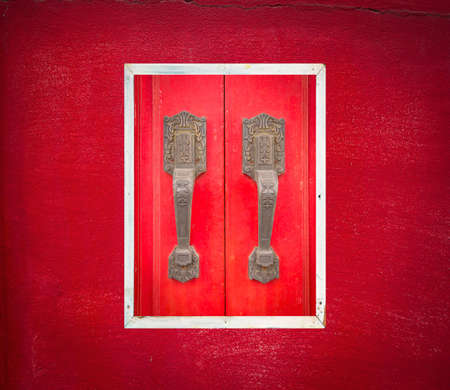 asian culture: The red wooden door are Chinese and East Asian culture.
