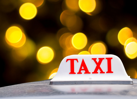 Taxi sign at night Stock Photo