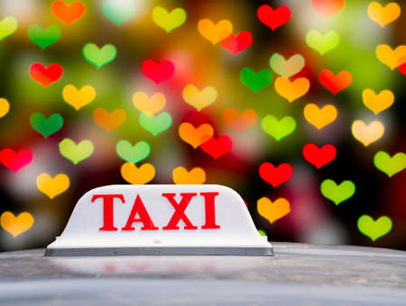 Taxi sign on Valentine hearts photo
