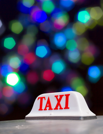 Taxi sign at night in Bangkok, Thailand. photo