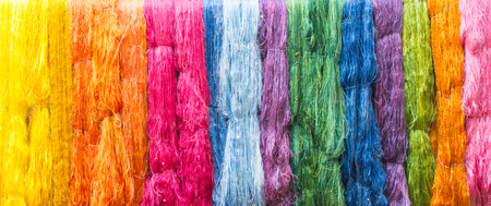 colorful of raw multicolored silk thread background photo