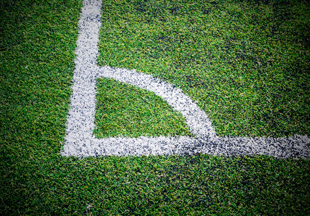 at the corner of football field.Soccer field artificial Grass. photo