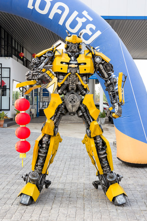 display figure: NAKORN RATCHASIMA,THAILAND - March 13, 2015 : The Replica of Optimus Prime robot made from scrap metal part of a Car display at Chevrolet Chokchai showroom.