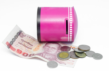Piggy bank on coin and cash , Thai currency photo
