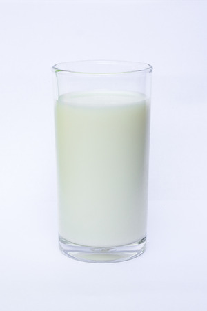 pasteurized: milk in the glass on white background