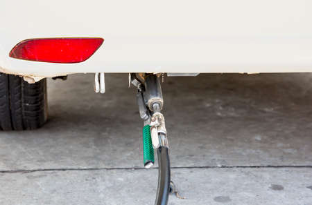 to fill up: A car fill up of LPG at gas station,(LPG) Liquefied petroleum gas pump Stock Photo