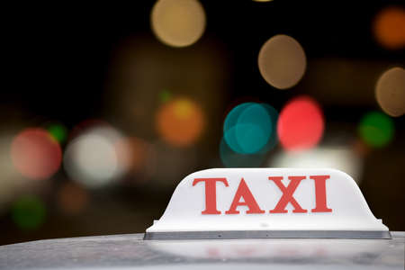 taxi sign: Taxi sign at night in Bangkok, Thailand.