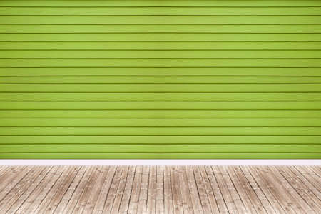 wooden floors: Background of green walls and old wooden floors.