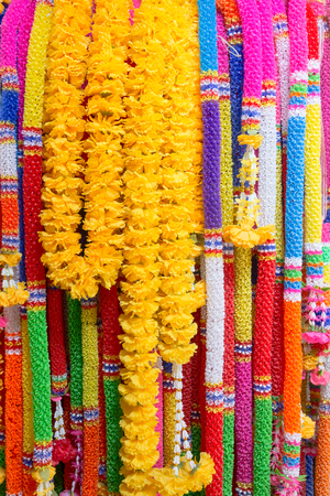 background of colorful plastic garlands for worship