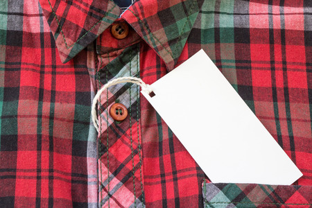 label tag: Close - up Blank tag label on red shirt