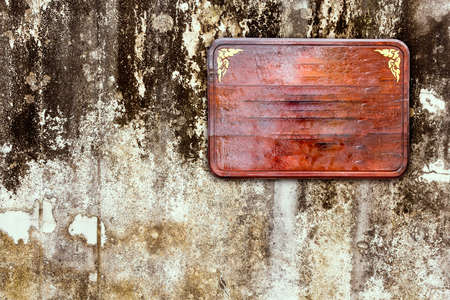 old sign: Wooden sign on old brick wall Stock Photo