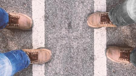 men standing: Men standing on the street