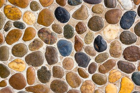 piso piedra: Textura de la pared de roca de piedra redonda y de fondo sin fisuras