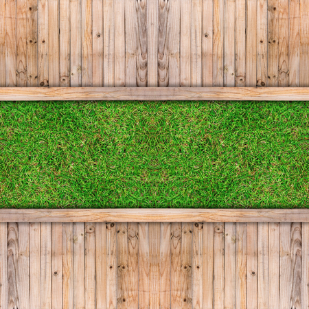 wood panel: old wooden with green grass in the garden. Stock Photo