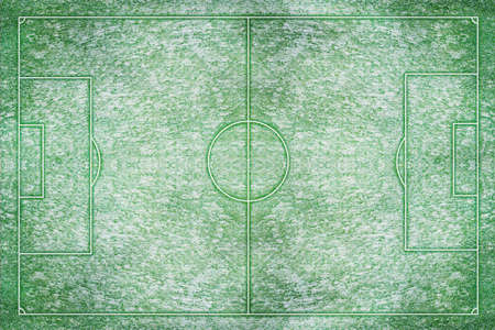 football pitch: A artificial textured grass football and field in winter snow