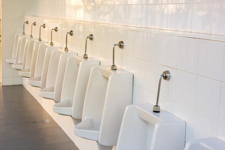 latrine: modern restroom interior with urinal row