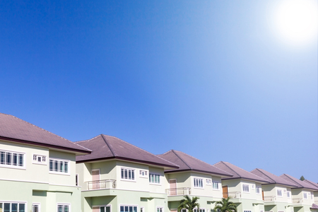 suburb: Row of new houses in suburb, sunny blue sky background