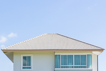 proprietary: building a new roof of home, blue sky as background Stock Photo