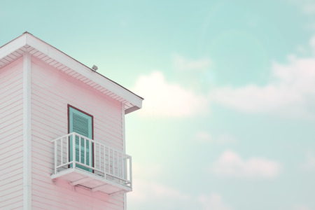 country house style: Vintage style. Old wooden country house with a balcony on a sunny day.