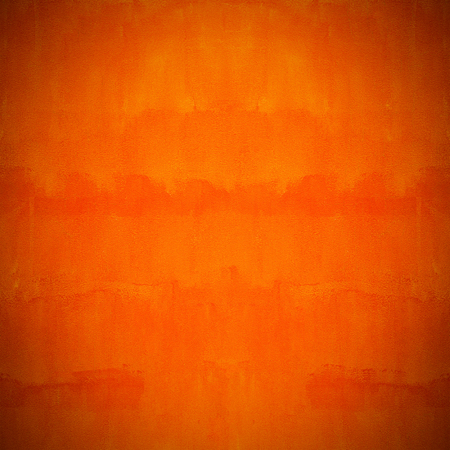 macro: Orange wall, orange cement texture background.