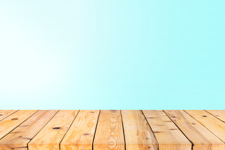 countertop: Wood table top on blue wall background Stock Photo
