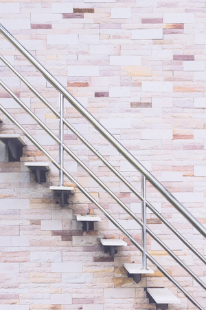 escape: Fire escape stairs with stone wall