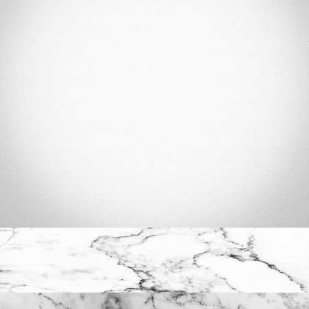 marble wall: Marble deck table on white wall background. Vintage color tone style.