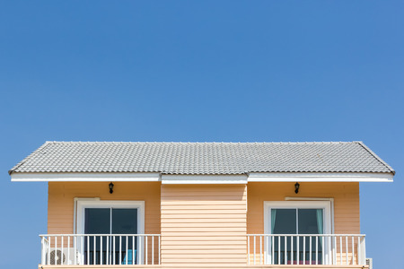 proprietary: building a new roof of home, blue sky as background Editorial