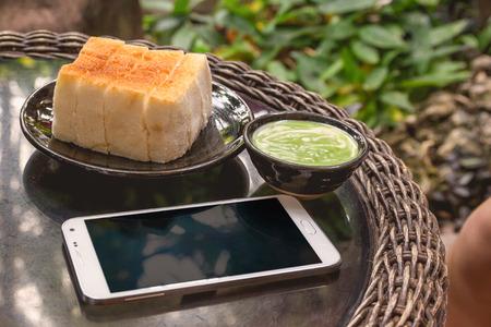 pandan: Steamed bread and pandan custard in restaurant, Thai dessert. Stock Photo