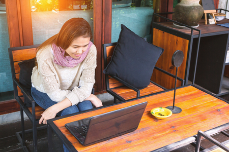 freelancer: Beautiful freelancer woman using laptop at the cafe Stock Photo