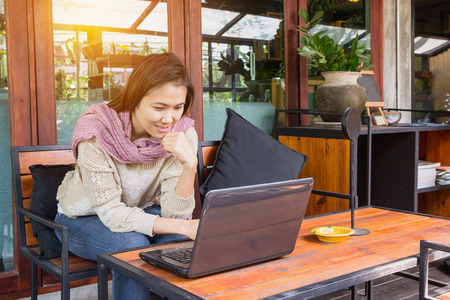 Beautiful freelancer woman using laptop at the cafe Stock Photo