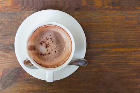stimulating: Empty hot coffee cup after drink on wood table. Stock Photo