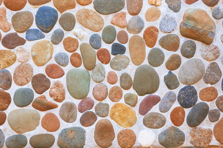rock wall: Pebble texture. Wall round stone rock texture and seamless background. Stock Photo