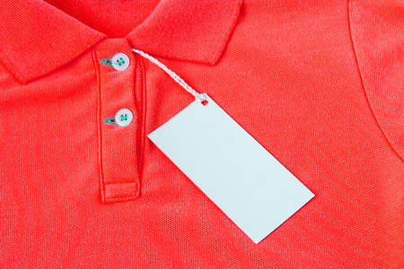 label tag: Closeup of blank tag label on red shirt