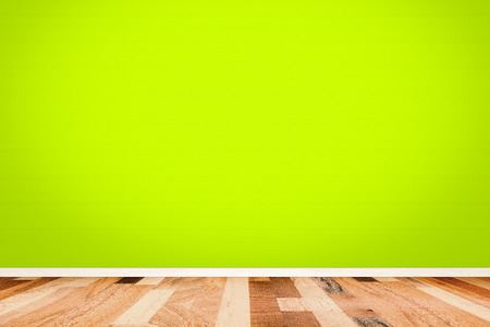 green house effect: Green room wall with wooden floor texture. Stock Photo